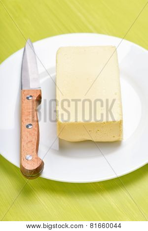 Butter And Knife On White Plate