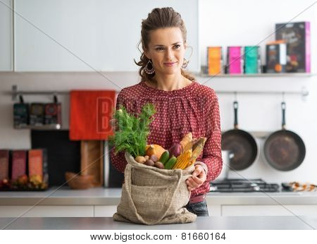 Portrait Of Young Housewife With Local Market Purchases In Kitch
