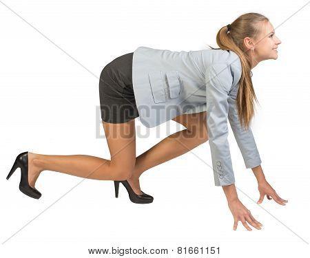 Businesswoman standing in running start pose