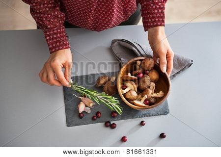 Closeup On Young Housewife Cooking Mushrooms