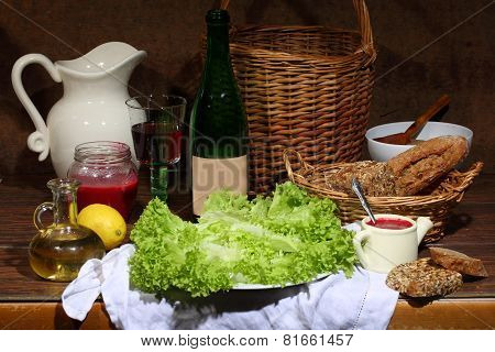 Wine, Cowberry Sauce And Salad Leaves