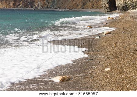 Golden Sand Seashore And Sea Wave In Crimea