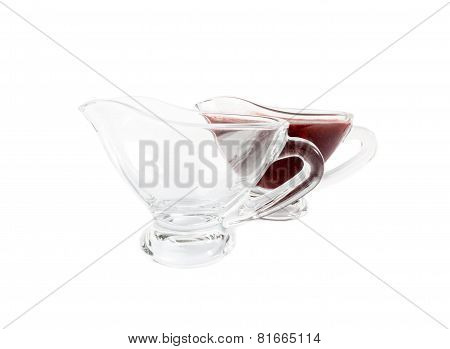 Empty glass saucers and Sauce tkemali in glass saucers. Cherry plum sauce.