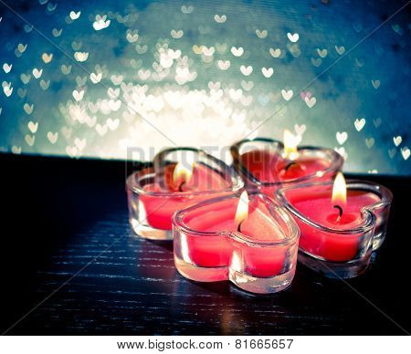Red Burning Heart Shaped Candles On Blue Hearts Bokeh