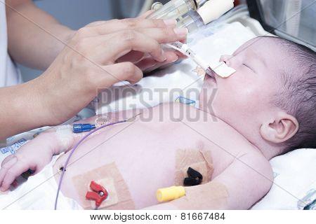 Newborn And Hand