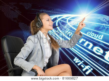 Businesswoman in headset touching or pressing something
