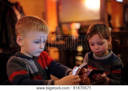 Two Children With Smartphones