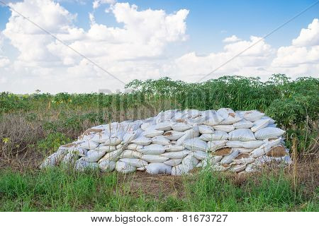 Bags Of Fertilizer Placed In The Land