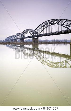 Iron bridge over the Po river. Color image