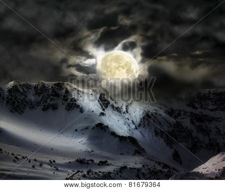 The Full Moon In The Sky Over The Mountain Snow Peak
