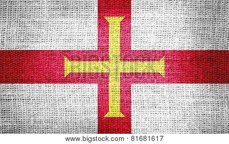 Guernsey flag on burlap fabric
