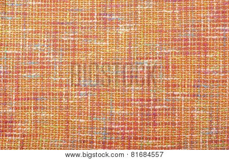 Orange woven with threads plaid fabric.
