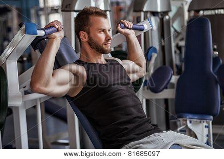 young man in sport gym club