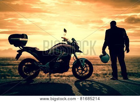 Biker On A Misty Sunset