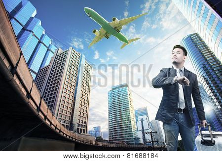 Young Business Man And Belonging Luggage Standing Against Building Urban Scene Looking To Sky With P