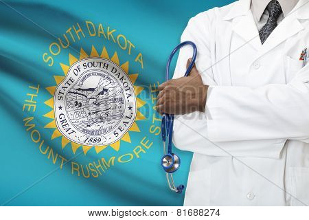 Concept Of National Healthcare System - South Dakota flag on background