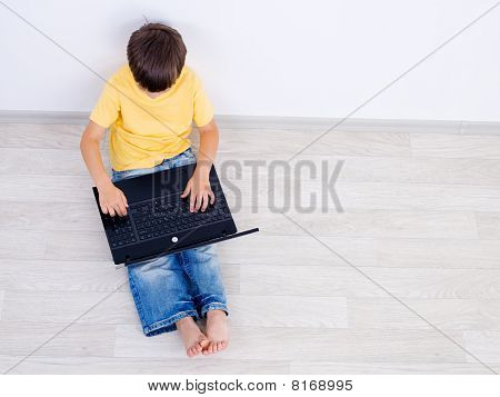Little Boy Using Laptop - High Angle