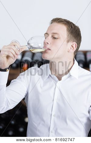 Man Tasting A Glass Of White Wine.
