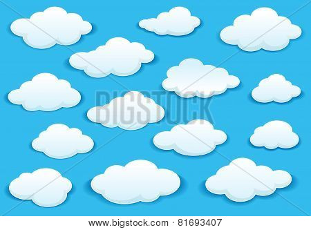White fluffy cloud icons on blue sky