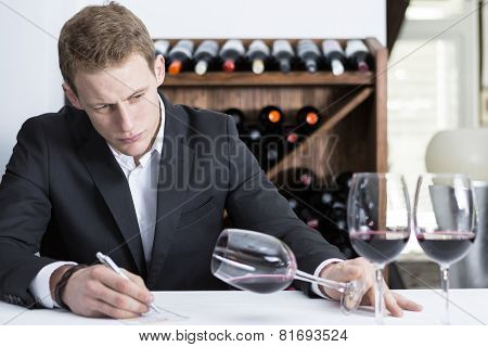 Winemaker Examining A Wine Glass.