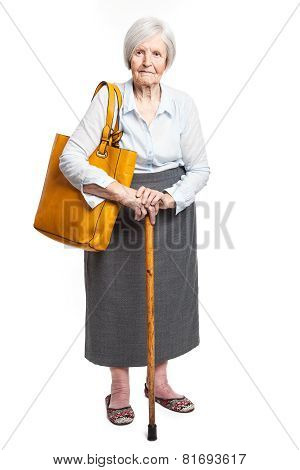Elegant senior woman with walking stick on white