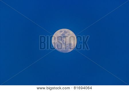 Close up of full moon seen on a clear sky evening using a telephoto lens