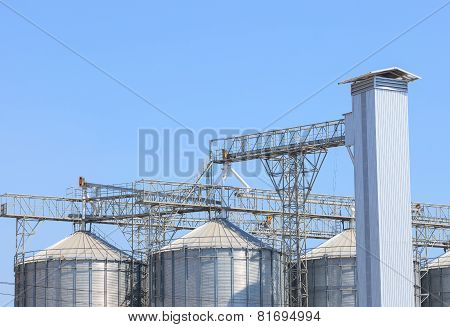 Exterior Structure Of New Agriculture Silo Building Against Blue Sky