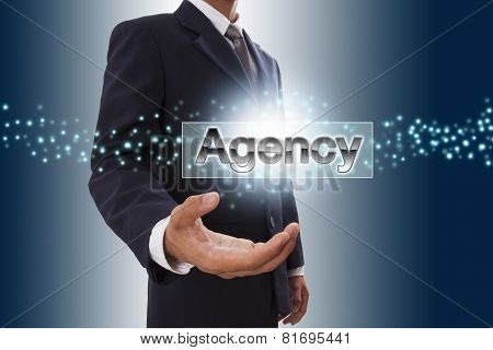 Businessman hand showing agency button