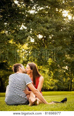 Young couple kissing on date