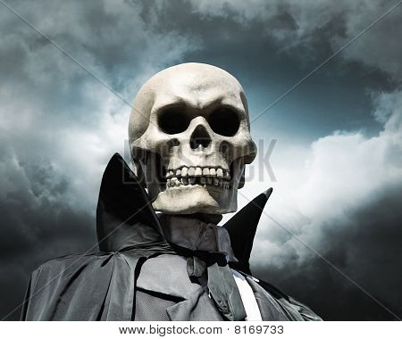 Grim Reaper. Death's Skeleton On A Cloudy Dramatic Sky