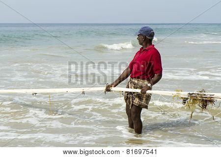 Fisherman Pulling A Fishing Net From The Arabian Sea