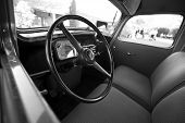 stock photo of veterans  - Black and white photo of an interior of an old veteran car with the steering wheel just in front - JPG