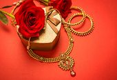 foto of laxmi  - Traditional indian gold necklace and bangles set arranged with heart - JPG
