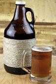 stock photo of growler  - Mug of hand crafted microbrew with growler - JPG