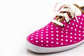 foto of pink shoes  - Pink polka dot canvas shoe on white background - JPG