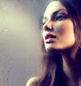 foto of rain  - Portrait of Beauty Girl behind the Wet Glass - JPG