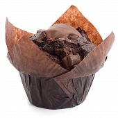 picture of chocolate muffin  - Chocolate chip muffin in brown wax paper.