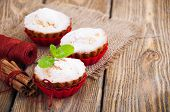 image of bakeshop  - Homemade Muffins Ready for Breakfast on a wooden background - JPG