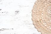 foto of doilies  - Crochet doily border over a white shabby chic wood - JPG