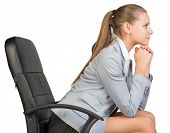 image of recliner  - Businesswoman on office chair - JPG