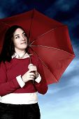 girl with umbrella in a bad weather day poster