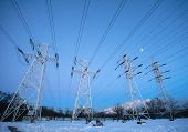 image of electricity pylon  - Electricity pylons and power high voltage power tower in winter evening - JPG