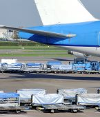 stock photo of loading dock  - Loading an airplane with airfreight at an airport - JPG