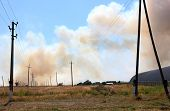 pic of steppes  - Smoke from the fire of the steppe near settlement - JPG