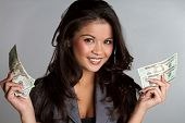 picture of twenty dollars  - Beautiful happy smiling business woman holding money - JPG