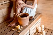 foto of sauna  - Young woman in white towel resting in Finnish sauna - JPG