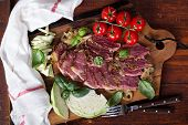 image of brisket  - Beef brisket with onions and cabbage cut on board - JPG