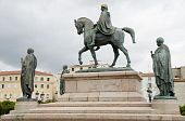 foto of bonaparte  - statue Napoleon Bonaparte and his brothers in Diamant Square Ajaccio Corsica France with old city in background - JPG