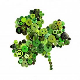 stock photo of shamrocks  - St Patricks Day shamrock of green buttons over a white background - JPG