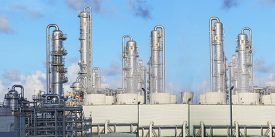pic of refinery  - exterior of oil refinery chimney tube building in heavy petroleum and petrochemical industry estate use for fussil fuelenergy and gas power industrial - JPG